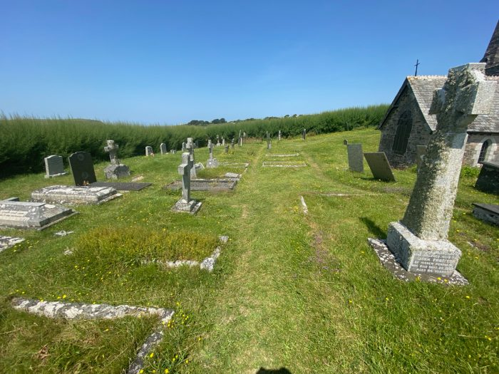 This image has an empty alt attribute; its file name is graveyard-St-Enodocs-Church-cornwall-700x525.jpg