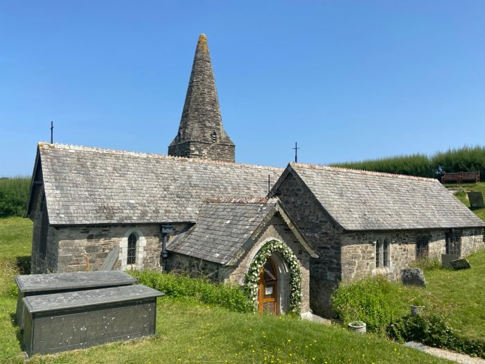 This image has an empty alt attribute; its file name is st-enodoc-church-trebetherick-st-minver-cornwall-700x525.jpg